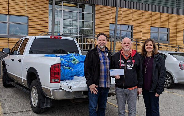 Randy Ahmann with Bite 2 Go deliveries for local school