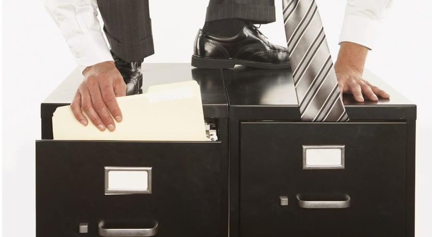 office worker ninja tie in file cabinet