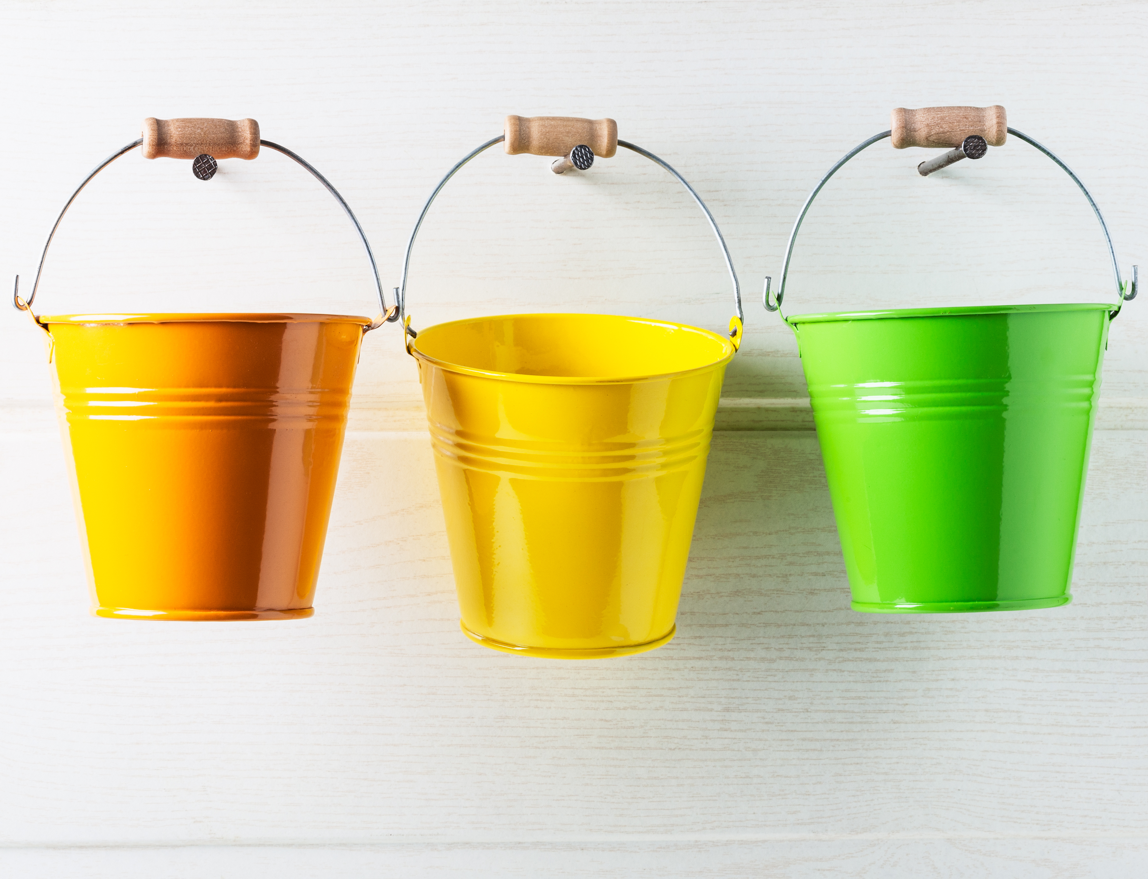 Row of colorful hanging buckets